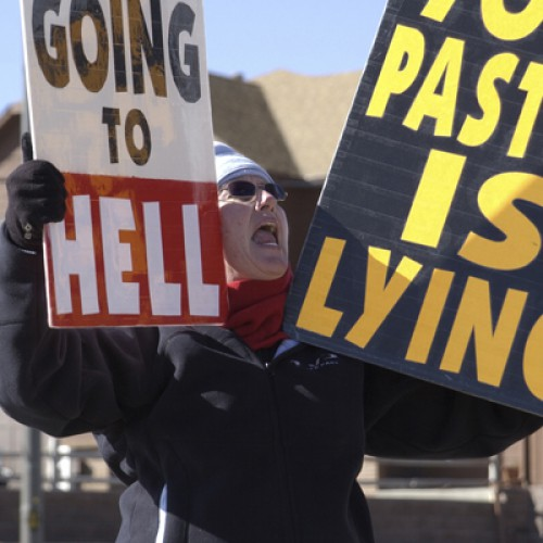 Members of Fred Phelps' movement protest in front of church in Lakewood, CO.